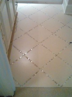 tile installation: inexpensive ceramic tile -- installed diagonally, with backsplash mosaic tile of the same thickness installed in between each tile.  Very elegant & cost effective.