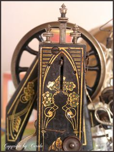 Absolutely Artful close-up of a vintage sewing machine w/painted forget-me-nots in the Art Nouveau style