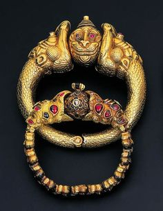 ndia | A pair of 'Garuda Head' bracelets | gold with diamond, ruby and emerald details | ca. late 19th century, South India