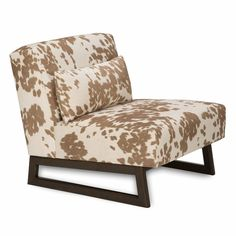 Add a pop of trendy design to your home with this Bodega chair from Jar Designs. With a durable wooden frame and cow hide print, this furniture is a great way to relax in style.