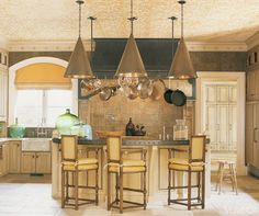 <p>The designer gestures toward the medieval with hammered bronze and copper pendant lamps, metal wall tiles and a metal-clad island counter. </p> <p><em>Oly pendant lamps. Walker Zanger wall ties. Dennis & Leen chairs in Tyler Graphic fabric. Custom copper countertop on island. </em><em>Image originally appeared in the April 2008 issue of Veranda.</em></p> <div>INTERIOR DESIGN BY<strong> BARRY DIXON</strong></div>