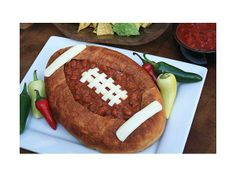 Chili in a football bread bowl  http://greatideas.people.com/2014/01/23/super-bowl-game-day-football-shaped-foods-snack/