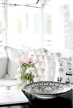 Pretty pastel pink, black and white and grey living room inspiration. Love the cushions.