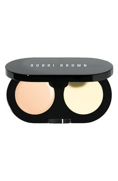 Bobbi Brown Creamy Concealer Kit in Warm Ivory. I love this stuff! Really covers my dark circles. I mix this with a TINY drop of the MUFE HD Invisible Cover foundation to help it blend with the rest of my face.