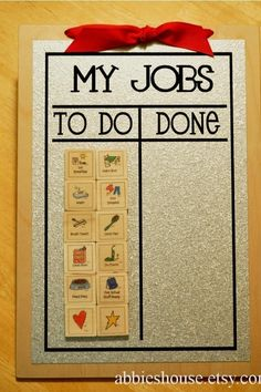 Chore Chart made with wood, metal, and magnets. The pictures are perfect for little ones who don't read.