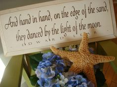 """Sign:  """"And hand in hand, on the edge of the sand, they danced by the light of the moon.""""  Cute idea for a wedding or just a home decoration."""