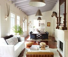 I love many things about this room - the layout, the large dining table, the antlers, the ceiling, the lightness.