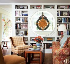 "As part of the reorganization of the space, the architect carved out a sitting area in the upstairs landing. ""I love little sitting areas,"" Bergen says. Floral sofa and pillow fabric from Stark; blue pillow fabric from Clearance House. Schumacher plaid 