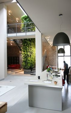 interior green wall + pale brick + simple floor + simple stairs and railing  ~via tumblr justthedesign