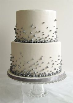 Flour fancies. This is the cake I made for my daughter's friend's wedding except just one level, silver fondant with white pearl candies, and two black white chocolate guitars on top! It was perfect for her rock and roll with a little glamour wedding! B