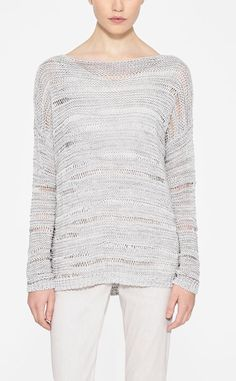 A flash of inspiration. This sweater features an attractive metallic sheen and textured knitting. Subtle ribbing defines the waistline hem for quiet detail. The impressionable knit pairs cleverly with straight linen pants, an Essential T-shirt, and one of this season's handbags.