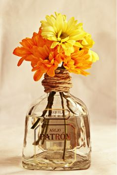 A Leftover Patron Bottle as a flower vase - hello helpful recycling.