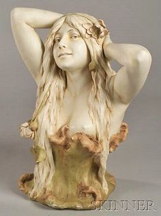 Royal Dux ~ Earthenware figural bust ~Depicting a Water Nymph ~ The girl is rising from a pool ~ Her arms behind her head ~ waterlilies in he hair ~ Streaming down over her naked shoulders ~ circa 1901-1925
