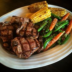 Serving family style tonight - grilled lamb chops, chilli lime corn, ginger glazed carrots and snap peas. @zimmysnook