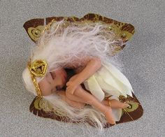 "This is ""Suzette"" which means in fairy language ""Little Lily.""She is snuggled up sleeping in Fairy dreamland. Collectible Doll  This sweet little fairy is wearing a cream and pale yellow petal dress.  Suzette measures 3"" in her lying position.  - SOLD"