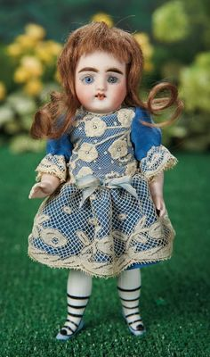 """7"""" Large German All-Bisque Miniature Doll with Very Rare Stockings and Shoes~~~peg-jointed bisque arms and shapely legs, silk and lace costume.  Marks: 41-17 G.K. Comments: Gebruder Kuhnlenz, circa 1890. Value Points: pretty face, very rare painted white ribbed mid-thigh stockings and five-lace blue ankle boots with black heels."""