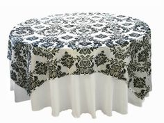 Black and white elegant table cover is perfect for a Phantom of the Opera themed party. Form the article: Phantom of the Opera Party Ideas:http://www.squidoo.com/phantom-of-the-opera-party-ideas