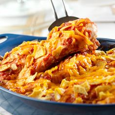 Spicy south-of-the-border flavors are featured when chicken breasts are baked in a picante sauce and topped with crunchy tortilla chips and melted Cheddar cheese.