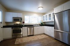 Pinned for wider counter-depth refrigerator (prob side by side), microwave off of counter, all white kitchen with black counter top, and cabinet ideas. Would probably keep white stove, dishwasher vs. Counter Depth Refrigerator Dimensions, Best Counter Depth Refrigerator, Kitchen Layout, Diy Kitchen, Kitchen Ideas, Kitchenaid Refrigerator, White Stove, L Shaped Kitchen