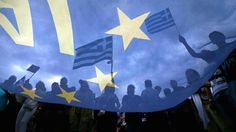 Pro-Euro protesters hold Greek flags during a rally in front of parliament in Athens, June 30, 2015.