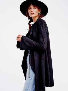 Faux Suede Meadow Jacket | Boho faux suede jacket is featured in a midi silhouette with a waterfall front and adjustable ties.  This unlined and collarless style has an unfinished trim. Hip pockets.