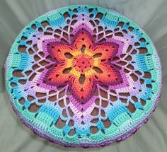 Stool cover made using the free Starflower Mandala by zelna olivier from Zooty Owl