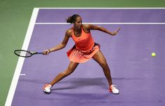 Madison Keys Photos Photos - Madison Keys of the United States plays a forehand in her singles match against Dominika Cibulkova of Slovakia during day 3 of the BNP Paribas WTA Finals Singapore at Singapore Sports Hub on October 25, 2016 in Singapore. - BNP Paribas WTA Finals: Singapore 2016 - Day Three