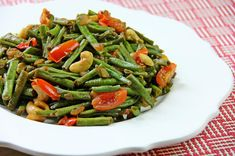 A stirfry Caribbean style with bodi (yard beans) and cashews. Vegetarian friendly and french and/or string beans can be used a swell. Click for the full recipe with cooking demo.
