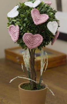 Use this amazing pattern from Red Heart Yarn to make a standing topiary. This can be used for a Valentine's presentation, a wedding centerpiece, a bridal shower or baby shower piece of decor.