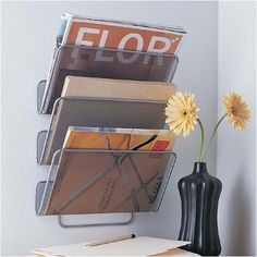This small silver mesh wall mounting magazine rack has three angled storage pockets. Each pocket can hold approximately 6 to 8 magazines or newspapers Wall File Organizer, Stacking Shelves, Howard Storage, Dorm Room Storage, Magazine Storage, Magazine Racks, Storage Organization, Organizing, Storage Ideas