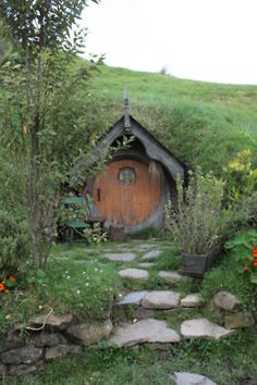 This is kinda what I want the backdoor of my bermed earthbag house to look like... and this little trail from the door leads to the pond area