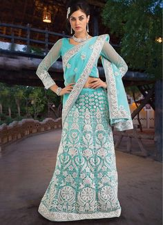 Opulent Lehenga Saree in a light blue-green.