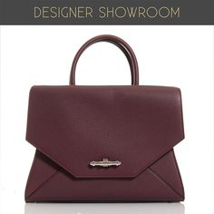 Beautifully and uniquely designed, this burgundy textured leather tote makes a stand-out piece to take you from work to the weekend, with its convertible styling. The bag features an origami-like silhouette, two rolled top handles, and a removable shoulder strap for easy carrying.