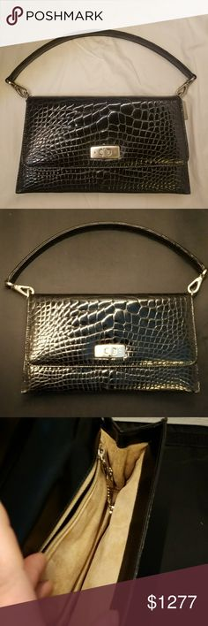 COACH EXOTICS - Gramercy Collection Alligator NWOT - NEVER USED COACH GENUINE ALLIGATOR from their exotics line... Circa 1993ish. Made in Italy.  Silver turnlock, buckles, fasteners & hangtag. Exterior is of alligator with shiny black finish. Lined in velvety soft beige suede. Interior has one main compartment with one zippered pocket. Coach Bags Shoulder Bags