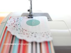 Sewing on project life cards.