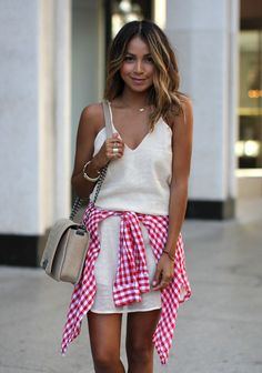 gingham shirt tied around waist
