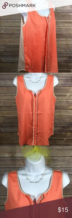 Naked Zebra Womens Orange and Tan Tank Top, Medium Naked Zebra Womens Two Colored Tank Top Front:  Orange V neck with Tan Trim Back:  Tan with Orange Trim Color:  Orange and Tan  Size:  Medium Approximate Top Shoulder to Bottom Hem Measurements:  24.5 inches Approximate Arm to Arm Measurements:  20 inches RN# 136628 Style# NT1199 Made in China  100 % Polyester Excellent Used Condition Naked Zebra Tops Tank Tops