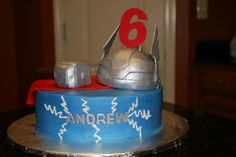 My son wanted a Thor themed cake for his birthday.  After not finding much online for ideas/inspiration I had to get creative!  It is all edible.  Helmet and hammer are RKT and fondant/gumpaste.