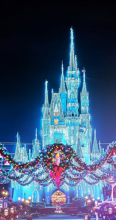 Christmas Disney Magic Kingdom Castle with the wreaths (photographer unknown) Have a wonderful Christmas - stay at http://www.orlandocondoatlegacydunes.com