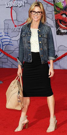 Last Night's Look: Love It or Leave It? | JULIE BOWEN | Dressed casually in a Catherine Deane dress and denim jacket (not to mention those glasses!), the Modern Family star hits up the premiere of Muppets Most Wanted in L.A.
