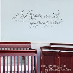 Vinyl wall decal A dream is a wish your heart makes. Beautiful in little girls room or nursery. Whimsical, Curly, Script Vinyl is Aprox 40 x