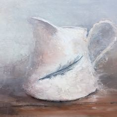 White jug with feather