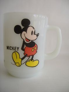 Had one just like this.... Vintage Anchor Hocking Mickey Mouse Cup.  via Etsy.