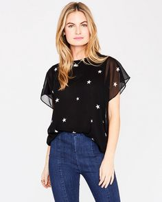 A bit of flounce on the sleeve and a sprinkling of stars makes this a cute and fun top to add to your weekend essentials. Wear alone over denim & joggers or try layered with a cardi & leggings. Denim Joggers, Rachel Roy, Nice Tops, Black Tops, Ruffle Blouse, Stars, Sleeves, How To Wear, Shopping