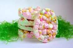 Easter Marshmallow Bark:  •1 bag white chocolate chips {12 oz}  •3 cups mini rainbow marshmallows  •about 1 TBSP shortening {optional, but it really makes the melting process easier!}  •Easter sprinkles or other fun sprinkles for decorations on top!  Cut into shapes or circles with cookie cutters.