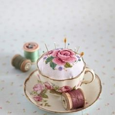 cross-stitch or embroider your own pin cushion to set into a vintage teacup
