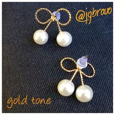 Ribbon/Bow Shaped Earrings (only gold available) Ribbon/Bow Shaped Earrings with Faux Pearls.  Very cute earrings for any age.  Ribbon or bow shaped earrings faux pearl accent.  Comes in gold or silver tone.  3rd photo is for reference only. PLEASE DO NOT PURCHASE THIS POST.  IF YOUR INTERESTED, I WILL CREATE A SEPARATE LISTING FOR YOU.  Please specify if you prefer gold or silver or both.  Sold as individual.  BUNDLES ARE WELCOME. Thank you. God bless you Jewelry Earrings
