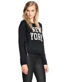 Show some love for New York in this black long-sleeved sweatshirt with side zippers. | H&M Divided