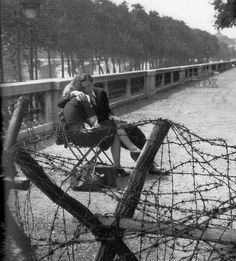 bowlersandhighcollars:  Lovers in occupied Paris. 1940.  Robert Doisneau.