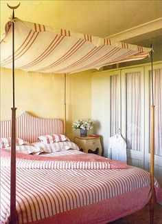 stripes in bed and canopy in Portofino, Italy